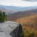 Hikers are rewarded with sweeping views of fall foliage at the top of Mount Pemigewasset.- Ultimate Leaf-Peeping Road Trip through New England