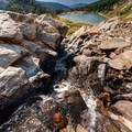 Glacier runoff from Silver Creek feeds the lake.- Epic Adventures in Colorado's Indian Peaks Wilderness