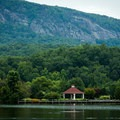 The shoreline of Lake Lure.- 10 Summer Escapes to Cool Off in North Carolina