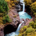 Awesome double waterfall on the South Fork Mineral Creek with willows starting to turn yellow at the end of the summer.- 30 Spectacular Fall Adventures in Colorado