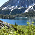 View of Craig Mountain (9,209 ft) looming over Ice Lake.- Amazing Alpine Lakes
