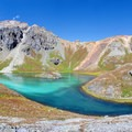Island Lake with its namesake rock island in the middle.- 10 Reasons to Visit the San Juan Mountains