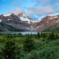 Lake Magog and Mount Assiniboine at sunrise.- 70 Breathtaking Backcountry Campsites