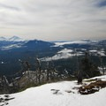 View from the summit looking west. Left to right: Broken Top (9,177'), Three Sisters, Black Crater (7,251'), Belknap Crater (6,877' ) and Mount Washington (7,795').- The Best Snowshoeing Near Bend, Oregon