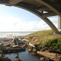Looking out over Spencer Creek under Highway 101 at Beverly Beach Campground.- Let's Go Camping