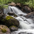 Don't miss the lovely falls below the lake.- Dillon Reservoir's Best Hikes, Rides + Camping