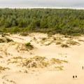 Hikers on the dunes trail look like ants.- Oregon Dunes Restoration