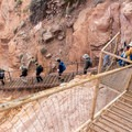 The descent into the canyon uses metal stairs and steps cut into sandstone.- Canyon De Chelly National Monument