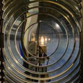 Fresnel lens and bulb of the Cape Blanco Lighthouse.- A Guide to Exploring Oregon's Lighthouses