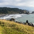 From the trail, Lone Ranch Beach can be seen below from the Cape Ferrelo Trail.- Guide to the Samuel H. Boardman State Scenic Corridor