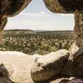 Imagine a pueblo dweller seeing this same view from inside this cave 700 years ago.- Six Must Do Hikes Around Santa Fe + Taos