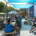 Folks enjoying the sun and the Block Party at Hops and Grain in Austin, Texas.- Outdoor Project's 2018 Block Party Festival Series Recap