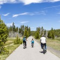 Bicycling along Upper Geyser Basin multi-use trail.- Yellowstone National Park