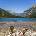 Relaxing by Avalanche Lake.- Glacier National Park
