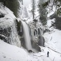 Contributor Shane Kucera at the base of 335-foot Falls Creek Falls.- 26 Amazing Snowshoe-to-Waterfall Adventures