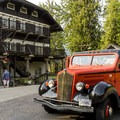 Lake McDonald Lodge and one of Glacier's vintage Red Jammer tour buses.- Glacier National Park