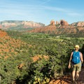 Cathedral Rock dominates the Pyramid Trail downhill.- Five Ways to Enjoy an Adventure Weekend in Sedona