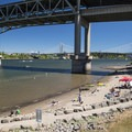 Poet's Beach on the Willamette River and the Marquam Bridge with Tilikum Crossing in the distance.- 31 Best Beaches + Swimming Holes in-and-around Portland, Oregon
