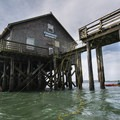 Kayaking below Pier's End Historic Coast Guard Boathouse.- River Mouths, Shipping, and Trade along the Oregon Coast