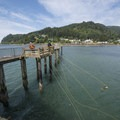 Crabbers on the pier at Pier's End Boathouse.- 5 Best Crabbing Locations on the Oregon Coast