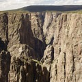 The steep quartz monzonite cliffs of the Black Canyon of the Gunnison from an overlook along North Rim Road.- Black Canyon of the Gunnison National Park