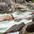 Lining up for a great run through a boney Wolf Creek on the Selway River.- 10 Great Rafting Trips in the Rocky Mountains