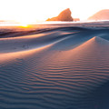 Sunset creates magical textures on the dunes at Myers Creek Beach.- Sink Your Toes into Miles of Sand
