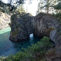 Natural arch in Thunder Rock Cove.- Guide to the Samuel H. Boardman State Scenic Corridor