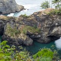 A closer look at the two bridges at Natural Bridges Viewpoint.- Guide to the Samuel H. Boardman State Scenic Corridor