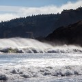 Crashing surf at Battle Rock Park in Port Orford.- River Mouths, Shipping, and Trade along the Oregon Coast