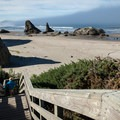 The stairs down to the beach from Face Rock State Scenic Viewpoint.- Oregon's 16 Best Beaches