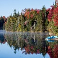 You can rent paddleboats, canoes, and kayaks at Woodford State Park until Columbus Day Weekend.- The Ultimate Fall Foliage Road Trip in Vermont