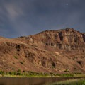A canyon wall by moonlight along the John Day River.- Meet the Oregon Natural Desert Association