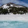 During some summers Lake Helen still has ice covering it.- Lassen Volcanic National Park