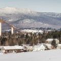 The ski jumps seen from Adirondack Loj Road.- Winter Destination Spotlight: 48 Hours in the Adirondacks