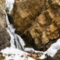 View of Hidden Falls obtained by crossing the streambed.- 26 Amazing Snowshoe-to-Waterfall Adventures