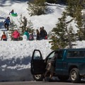 Families sledding near the visitor center at the southwest entrance to Lassen Volcanic National Park.- California Winter Adventures Beyond the Ski Slopes