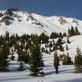 Beginning the traverse around the lower east-facing slopes of Lassen.- Where to Find Great Backcountry Skiing in Our National Parks