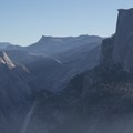 Sunrise illuminates the back of Half Dome as seen from Glacier Point.- Add a Stamp to Your Passport