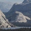 Granite domes tower above Tenaya Lake.- Backpacking Trips in Yosemite National Park