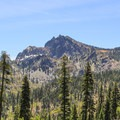 Sierra Buttes as seen form the road leading up to Packer Saddle. The fire lookout tower is perched on the summit.- 5 Reasons to visit Lakes Basin