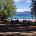 Picnic areas located behind the beach at Meeks Bay.- California's Best Lake Camping