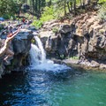 Jumping from the platform at Lower Falls on the McCloud River.- California's 35 Best Swimming Holes