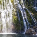 Swimming at the foot of Middle Falls on the McCloud River.- Examining The Sacramento Watershed: The Conservation