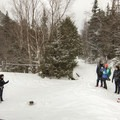 A group at the Marcy Dam.- Winter Destination Spotlight: 48 Hours in the Adirondacks