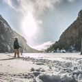 Avalanche Lake anchors a stunning alpine vista in the winter.- The Best Winter Adventures in North America