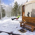 Enjoying some afternoon sun at the Bear Claw Yurt.- 7 New Ways to Explore Old Man Winter this Season