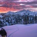 Touring up the west side of Edith Basin as the sun rises over the Tatoosh Range.- Backcountry Skiing in Washington