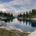 A large granite ledge is a perfect platform for jumping into Little Cyclone Lake.- Washington's Best Backpacking Trips