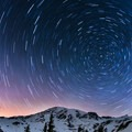 Headlamps at Edith Creek Basin illuminate multiple routes on Mount Rainier (14,411 ft).- Winter in Mount Rainier National Park